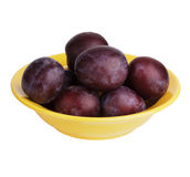 Several plums in a yellow plate Royalty Free Stock Photo