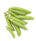 Several pods of green peas on a white background Stock Photography
