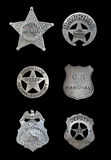 Several Police and Sheriff Badges. Several old, vintage sheriff, marshall, and police badges isolated over black stock photos
