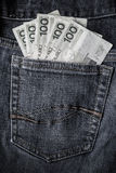 Several Polish banknotes jeans pocket Royalty Free Stock Photo
