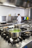 Several pots cooking on hotplate Royalty Free Stock Photo