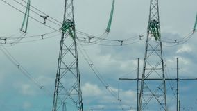 Several power lines are in the background of moving clouds. Panorama from the bottom up. HD stock video