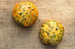 Several pumpkin buns with pumpkin seeds on burlap Royalty Free Stock Photo