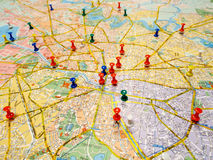 Several pushpins on a map Stock Photography