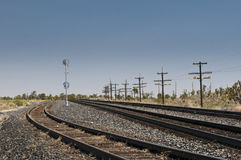 Several rails going through a desert in the USA Stock Photos