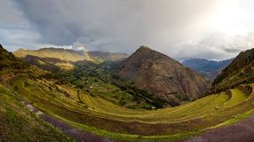 Several rainbows at Pisac monument in Peru royalty free stock photo