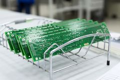Several ready-made printed circuit boards are installed in a metal stand. Manufacture of electronic components Stock Photography