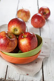 Red apples. Several of red apples in coloured plates on the white kitchen table Stock Photography