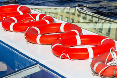 Several red lifebuoys Stock Image