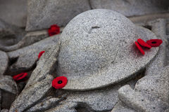 Poppies around War Memorial. Several red poppies are placed around a war memorial Royalty Free Stock Photo