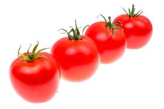 Several red ripe tomatoes isolated on white background. Studio Photo Stock Images