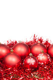 Several red Xtmas baubles and tinsel isolated Stock Images
