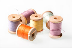 Several reels of thread. Under the light background Royalty Free Stock Image