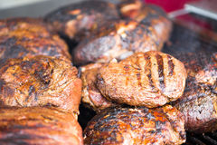 Several Rib-Eye Steaks Resting on a Grill Royalty Free Stock Image