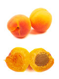 Several ripe orange apricots, peaches isolated on white backgrou Royalty Free Stock Image