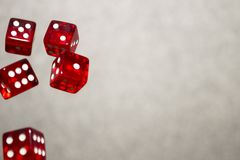 Several rolling red dice fall on a table with boardgame. Gameplay moments.  royalty free stock photos