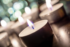 Several Romantic Candlelights At Night On Wooden Table With Bokeh And Crooked Angle Royalty Free Stock Image