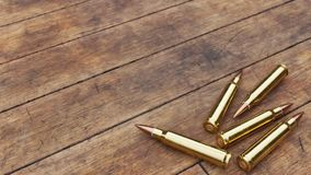 Rifle Ammunition on Old Wooden Boards Royalty Free Stock Photos