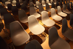 Several rows of chairs with metal legs Royalty Free Stock Image