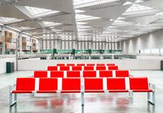Several rows of empty red seats. In the hall of a great station Royalty Free Stock Image