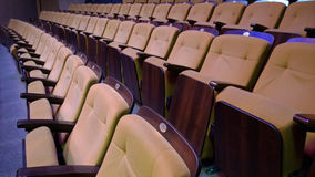 Several rows of folding comfortable padded seats royalty free stock image