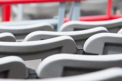Several rows of gray empty seats Royalty Free Stock Photos