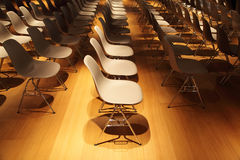 Several rows of plastic chairs Stock Photos