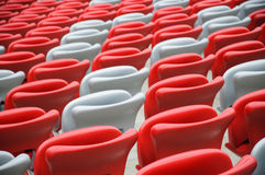Several rows of red and white stadium seats Stock Photo