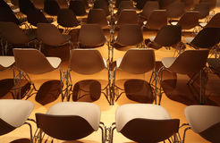 Several rows of white plastic chairs Stock Images