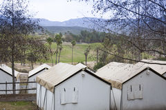Safari Tents Overlooking the Plains and Mountains Royalty Free Stock Photography