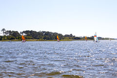 Several sailing boats in a lake near the coast Stock Images