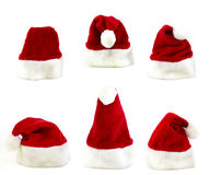 Several santa claus cap. In a white background Stock Photo