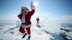 Several Santa Claus Passes Glacial Horses. Christmas holidays, Santa Claus walks around the lake Baikal, Siberia, Russia stock footage