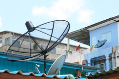 Several satellite dishes on building roof. Several satellite dishes attached on building roof and wall Royalty Free Stock Photography