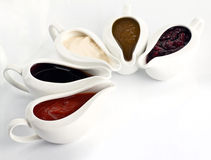 Several sauce with different sauces and seasonings. On white Stock Images