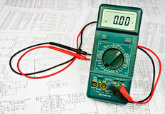 Several schemes and electrical tester Royalty Free Stock Images