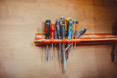 Screwdrivers hanging in the workshop stock image