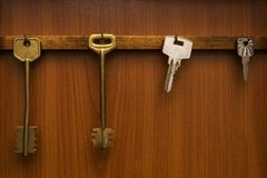 Several sets of keys hanging on hooks Royalty Free Stock Photography