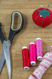 Several sewing tools with red pincushion Royalty Free Stock Photos