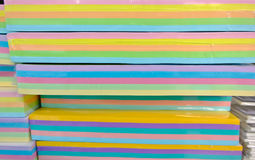 Several sheets of colored paper. Rainbow color spectrum of thick paper ends, from red to purple Stock Photos