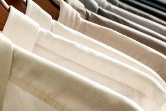 Several shirts on a hanger Stock Photos
