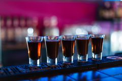 Several shots of different drinks at a party in a nightclub. stock photo