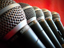 Several Shure microphones. Sm58 on a red background Royalty Free Stock Photo