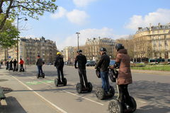Several sightseers taking a tour through the city on motorized scooters,Paris, France,2016 Stock Photo
