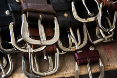 Several silver buckles of leather belts for sale at a flea marke Stock Images