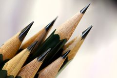 Sharpened Artists Pencils at angle. Several Sketch Pencils sharpened with fine points at acute angle Royalty Free Stock Images