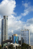 Skyscrapers Cluster. Several skyscrapers and office high-rises in a tight downtown cluster, on the background of beautiful cloudy spring skies Royalty Free Stock Photo