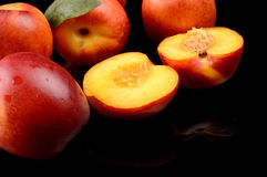 Several sliced nectarines isolated on black Stock Photography