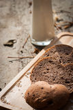 Several slices of Bread wheat and wooden chopping board Stock Photo