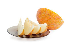 Several slices and half of melon on a light background Royalty Free Stock Photos